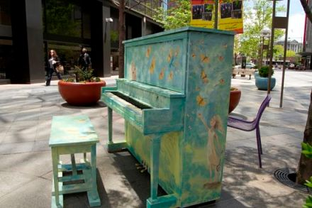 Photo of an outdoor piano.